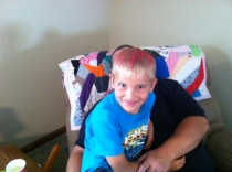Didn't want my nephew to be left out, and yes I paid him $20 bucks to let his mom put pink in his hair.  I'm a really good Aunt.